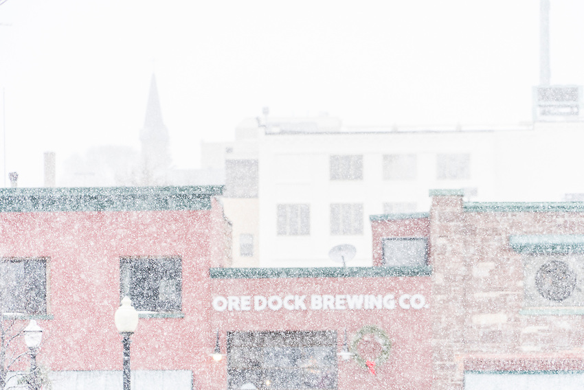 Ore Dock Brewing Company and downtown Marquette, Michigan during a snowstorm.