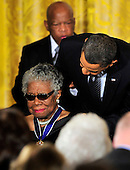 """United States President Barack Obama and first lady Michelle Obama present the 2010 Medal of Freedom, """"the Nation's highest civilian honor presented to individuals who have made especially meritorious contributions to the security or national interests of the United States, to world peace, or to cultural or other significant public or private endeavors"""", to celebrated author, poet, educator, producer, actress, filmmaker and civil rights activist Maya Angelou, in a ceremony in the East Room of the White House in Washington, D.C. on Tuesday, February 15, 2011..Credit: Ron Sachs / CNP"""