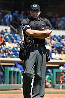 Home Plate Umpire John Mang (59) looks into the dugout between innings during a game between the Hartford Yard Goats and the Binghamton Rumble Ponies at Dunkin Donuts Park on May 9, 2018 in Hartford, Connecticut.<br /> (Gregory Vasil/Four Seam Images)