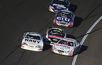 Mar 1, 2008; Las Vegas, NV, USA; Nascar Nationwide Series driver Mark Martin (5) hits Carl Edwards (60) and Brad Keselowski (88) during the Sams Town 300 at the Las Vegas Motor Speedway. Mandatory Credit: Mark J. Rebilas-US PRESSWIRE