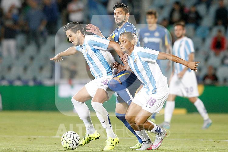 Getafe's Angel Lafita (c) and Malaga's Jose Luis Garcia Recio (l) and Roberto Rosales during La Liga match.September 18,2015. (ALTERPHOTOS/Acero)