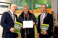 The Hugh O'Flaherty Gathering - Jerry O'Grady, pictured with Kerry Mayor John Brassil, left and Killarney Mayor John Joe Culloty, after receiving her commemorative certificate personally signed  by the President of Ireland Michael D Higgins at the launch of 'The Kerry Gathering Yearbook', a 130 page illustrated  book recording all the events of The Gathering 2013 published by Kerry County Council, in the Killarney Library on Thursday.<br /> Photo: Don MacMonagle<br /> <br /> Repro free from Kerry County Council<br /> <br /> The Kerry Gathering Yearbook is A130 page illustrated  book recording all the events of The Gathering 2013 published by Kerry County Council. T being published by Kerry County Council. The book was launched at Killarney Library (Thursday) in the presence of Gathering event organisers who  received complimentary copies of the Yearbook and individual certificates of appreciation personally and individually signed by the President of Ireland, Mr. Michael D. Higgins. <br />  The Gathering began as a tourism initiative led by F&aacute;ilte Ireland to attract overseas visitors to Ireland during the economic downturn but was embraced by community, sports, social and cultural groups throughout the country and transformed into a &ldquo;People&rsquo;s Project&rdquo; that captured the imagination of young and old alike.  There were 250 gatherings in Kerry which attracted 20,000 people and generated an estimated &euro;10 million for the local economy. Half of the total number of Kerry gatherings were community events. Kerry County Council set up a Gathering Events Office in the Ashe Memorial Hall in Tralee and provided financial and logistical support to event organizers.  Initiatives unique to Kerry were the Kerry Gathering TV and Genealogy Roadshow initiatives.  The Kerry Gathering Yearbook is also a first for an individual county.