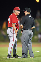 Carolina Mudcats manager Rocket Wheeler (18) questions a call with umpire Chris Scott during a game against the Frederick Keys on June 4, 2016 at Nymeo Field at Harry Grove Stadium in Frederick, Maryland.  Frederick defeated Carolina 5-4 in eleven innings.  (Mike Janes/Four Seam Images)