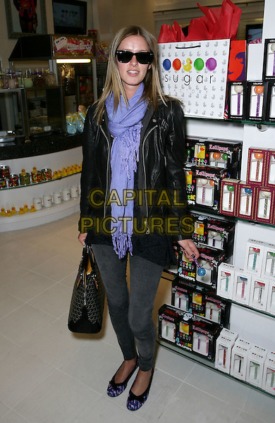 NICKY HILTON .Stops By Sugar Factory at the Miracle Mile Shops at Planet Hollywood Resort Hotel and Casino, Las Vegas, Nevada, USA, 19th March 2010.  .full length purple scarf sunglasses ballet pumps flats shoes black leather jacket bag print bows skinny jeans grey gray lolly pop lollypopRay Bans wayfarers .CAP/ADM/MJT.© MJT/AdMedia/Capital Pictures.