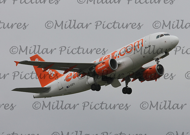 An easyJet Airbus A319-111 Registration G-EZFV at Glasgow Airport on 4.6.16 going to Alicante Airport.