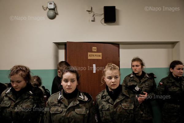 KALISZ, 7/03/2015:<br /> Czlonkowie organizacji &quot;Strzelec&quot; podczas alarmu nocnego o 3 nad ranem. W ten weekend czlonkowie organizacji zebrali sie w lokalnym liceum ogolnoksztalcacym na dwudniowe cwiczenia. Od rozpoczecia wojny na Ukrainie rozne organizacje paramilitarne staja sie coraz bardziej popularne.<br /> Fot: Piotr Malecki<br /> <br /> KALISZ, POLAND, MARCH 8, 2015:<br /> Young members of &quot;Strzelec&quot; (&quot;The Shooter&quot;) paramilitary association stand in line during the night alarm at 3 am. This weekend a few paramilitary groups from this region of Poland are having their trainining session, their base being a secondary school number 5 in Kalisz.<br /> Since the start of war in Ukraine, paramilitary associations are becoming more popular.<br /> (Photo by Piotr Malecki)