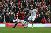 Pictured: (L-R) Javier Hernandez, Ashley Williams.<br /> Re: Barclay's Premier League, Manchester City FC v Swansea City FC at the Old Trafford Stadium, Manchester.