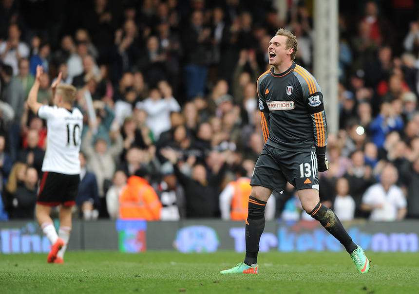 Fulham's David Stockdale celebrates at the final whistle after their 1-0 victory over Norwich City<br /> <br /> Photo by Ashley Western/CameraSport<br /> <br /> Football - Barclays Premiership - Fulham v Norwich City - Saturday 12th April 2014 - Craven Cottage - London<br /> <br /> &copy; CameraSport - 43 Linden Ave. Countesthorpe. Leicester. England. LE8 5PG - Tel: +44 (0) 116 277 4147 - admin@camerasport.com - www.camerasport.com