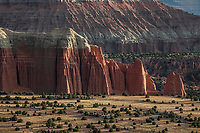 Light from a rising sun brightens Cathedral Valley at Capitol Reef National Park, Utah