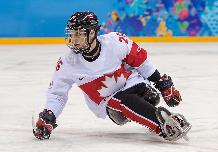 Sochi, RUSSIA - Mar 11 2014 -  Dominic Larocque as Canada takes on Czech Republic in Sledge Hockey at the 2014 Paralympic Winter Games in Sochi, Russia.  (Photo: Matthew Murnaghan/Canadian Paralympic Committee)
