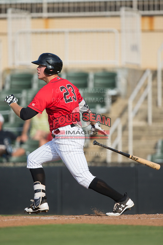 Gavin Sheets (23) of the Kannapolis Intimidators follows through on his swing against the Hagerstown Suns at Kannapolis Intimidators Stadium on July 9, 2017 in Kannapolis, North Carolina.  The Intimidators defeated the Suns 3-2 in game two of a double-header.  (Brian Westerholt/Four Seam Images)