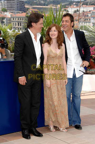 "JAVIER BARDEM, KELLY MacDONALD, JOSH BROLIN.""No Country for Old Men"" photocall,.60th International Cannes Film Festival,.Cannes, France, 19th May 2007..full length gold patterned print long maxi dress jeans white shirt black jacket sunglasses.CAP/PL.©Phil Loftus/Capital Pictures."