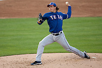 "Texas Rangers starting pitcher Derek Holland #45 delivers during the MLB exhibition baseball game against the ""AAA"" Round Rock Express on April 2, 2012 at the Dell Diamond in Round Rock, Texas. The Rangers out-slugged the Express 10-8. (Andrew Woolley / Four Seam Images)."
