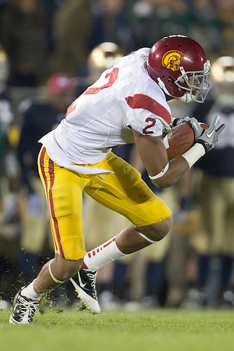 USC wide receiver Robert Woods (#2) runs for yardage during fourth quarter of NCAA football game between Notre Dame and USC.  The USC Trojans defeated the Notre Dame Fighting Irish 31-17 in game at Notre Dame Stadium in South Bend, Indiana.