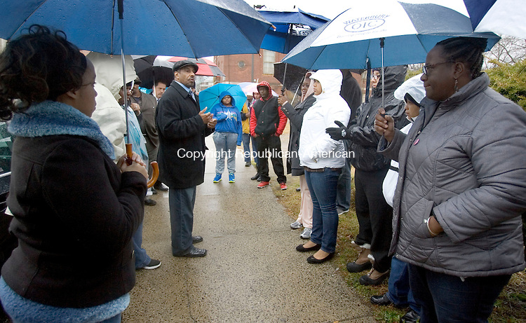WATERBURY CT. 05 December 2014-120614SV12-About 40 people gathered despite the cold rain this afternoon for a rally and march from Martin Luther King Jr. Memorial Park in Waterbury Saturday. The march was for what they say is unfair treatment of black men across America. <br /> Steven Valenti Republican-American