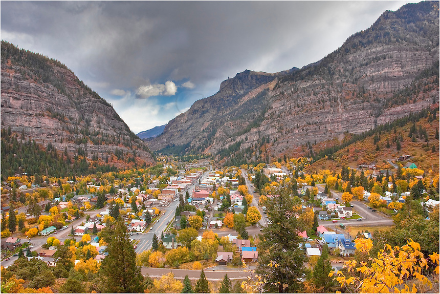 """Known as the """"Little Switzerland"""" of Colorado, Ouray is surrounded by high rising mountains in all directions. This image of Ouray was taken in Autumn when the aspen were gold and the air was cool and crisp."""