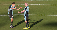 Luke O'Nien of Wycombe Wanderers with goalscorer Michael Harriman of Wycombe Wanderers on the final whistle during the Sky Bet League 2 match between Wycombe Wanderers and Mansfield Town at Adams Park, High Wycombe, England on 25 March 2016. Photo by Andy Rowland.
