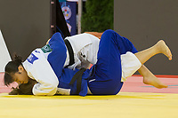 Saki Niizoe (top) of Japan and Sanne Van Dijke (bottom) of Netherlands fight during the Women -70 kg category at the Judo Grand Prix Budapest 2018 international judo tournament held in Budapest, Hungary on Aug. 11, 2018. ATTILA VOLGYI