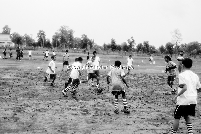 Students of Sukma Football academy practice in their ground at the educational complex in Sukma.Sukma, Chattisgarh, India. Arindam Mukherjee.
