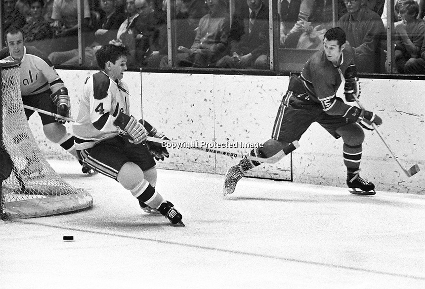 Seals vs Montreal 1970, Seals Harry Howell and #4 Wayne Muloin, Canadiens #15 Claude Larose..Ron Riesterer/photo