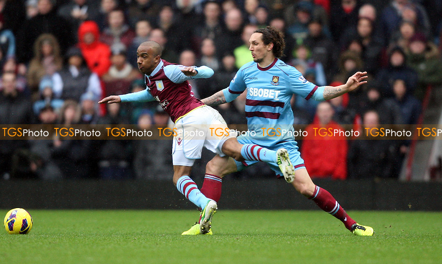 Fabian Delph of Aston Villa is taken down by Emanuel Pogatetz of West Ham - Aston Villa vs West Ham United, Barclays Premier League at Villa Park - 10/02/13 - MANDATORY CREDIT: Rob Newell/TGSPHOTO - Self billing applies where appropriate - 0845 094 6026 - contact@tgsphoto.co.uk - NO UNPAID USE.