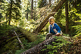 USA, Oregon, Oregon Cascades, young boy plays in the in the Wilamette National Forest in the early Fall on the hike to Proxy Falls