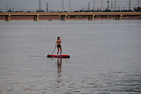 Tempe, Arizona. A woman on an inflatable device on Tempe Town Lake at sunset. Photo by Eduardo Barraza © 2015