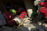 Port au Prince, Haiti, January 15 2010.The Belgian B-FAST rapid intervention team has successfully extracted several survivors from collapsed buildings. Maryse, 43 has spent 72 hours under the ruins of her house, next to her parents' bodies; she suffers only from a simple broken leg.