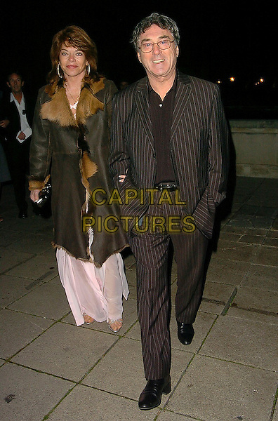 BILLY MURRAY & GUEST.Frank Lampard's Evening For Teenage Cancer Trust, Old Billingsgate Market, London, UK..November 20th, 2005.Ref: CAN.full length black suit jacket brown leather jacket fur trim.www.capitalpictures.com.sales@capitalpictures.com.©Capital Pictures