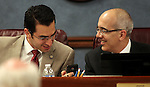Nevada Sens. Ruben Kihuen, left, and Mo Denis, both D-Las Vegas, look at an electronic device at the Legislature in Carson City, Nev., on April 1, 2011.  .Photo by Cathleen Allison