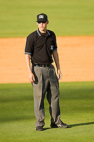 Umpire Alex Ziegler handles the calls on the bases during the South Atlantic League game between the Lexington Legends and the Kannapolis Intimidators at CMC-Northeast Stadium on May 20, 2012 in Kannapolis, North Carolina.  The Legends defeated the Intimidators 7-1.  (Brian Westerholt/Four Seam Images)