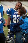 Junior Matt Lewis receives a hug from a Friendswood fan following the Mustangs' loss to the Lake Travis Cavaliers.  The Mustangs lost 24 - 3 at Kyle Field on December 11, 2010 in the Class 4A, D-1 state semifinals.