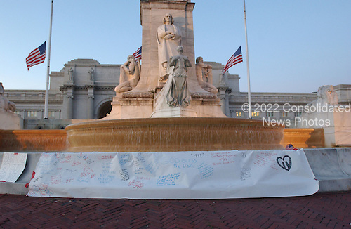 A piece of white paper is attached to the base of the Columbus Fountain at Washington's Union Station for people to write tributes to the victims of the terrorist attacks in New York and Washington on Wednesday, September 12, 2001..Credit: Ron Sachs / CNP