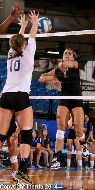 BROOKINGS, SD - SEPTEMBER 5:  Ashley Beaner #1 from South Dakota State looks to get a kill past Jill Ivy #10 from Stephen F. Austin during their match Friday afternoon at Frost Arena in Brookings. (Photo/Dave Eggen/Inertia)