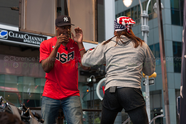USA Olympic Boxing Team members Marcus Browne and Marlen Esparza participate in a boxing demonstration at the Road to London 100 Days Out Celebration in Times Square in New York City, New York, USA on Wednesday, April 18, 2012.  Times Square was transformed into an Olympic Village for the event.