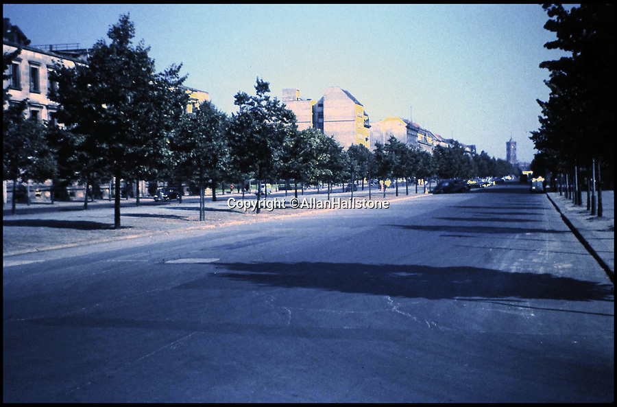 BNPS.co.uk (01202 558833)<br /> Pic: AllanHailstone/BNPS<br /> <br /> Deserted Unter den Linden in East Berlin in 1959. <br /> <br /> New book reveals unseen pictures of the bleak landscape of Cold War Berlin.<br /> <br /> The remarkable photos were taken by a British visitor before and after the Berlin Wall was built in 1961.<br /> <br /> Retired coin dealer Allan Hailstone visited Berlin several times between 1959 and 1966 and took hundreds of photos of both West Berlin and East Berlin.<br /> <br /> The 78 year old was struck by the stark contrast between the vibrant, colourful West Berlin he encountered and rubble-filled, sparse East Berlin.<br /> <br /> During his first visit to Berlin in 1959, Mr Hailstone was able to walk freely between the two sides of the city, but this changed when he returned in 1962 as the Berlin Wall had been built to stop east Berliners from escaping to the west.
