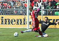 30 March 2013:Toronto FC forward Robert Earnshaw #10 takes the ball past Los Angeles Galaxy goalkeeper Carlo Cudicini #1 to score a goal on an open net during an MLS game between the LA Galaxy and Toronto FC at BMO Field in Toronto, Ontario Canada..The game ended in a 2-2 draw..