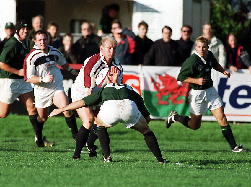 Photo. Richard Lane..London Irish v Swansea. 17/10/98. Tyrone Maullin prepares to take the tackle of Brendan Venter.