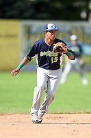 Vermont Lake Monsters shortstop Yairo Munoz (15) fields a ground ball during a game against the Jamestown Jammers on July 13, 2014 at Russell Diethrick Park in Jamestown, New York.  Jamestown defeated Vermont 6-2.  (Mike Janes/Four Seam Images)