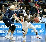SIOUX FALLS, SD - MARCH 20: Ike Agusi #0 from Queens University looks to drive past Jason Todd #10 from Cal Baptist during their quarterfinal game at the 2018 Elite Eight Men's NCAA DII Basketball Championship at the Sanford Pentagon in Sioux Falls, SD. (Photo by Dave Eggen/Inertia)