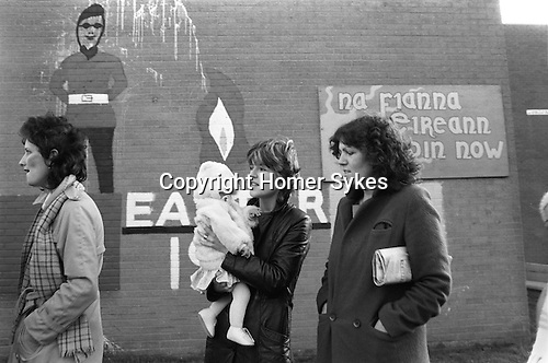 Derry Northern Ireland Londonderry 1983. Catholic families waiting for the bus to take them to Longkesh  to visit family members in prison.