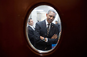 United States President Barack Obama is seen through a door to the pantry near the State Dining Room of the White House as he waits to meet with the National Governors Association, February 25, 2013. .Mandatory Credit: Pete Souza - White House via CNP