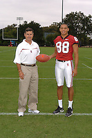 7 August 2006: Stanford Cardinal head coach Walt Harris and Michael Miller during Stanford Football's Team Photo Day at Stanford Football's Practice Field in Stanford, CA.