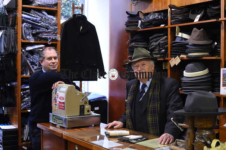 Oliver Moylan and his son Peter in The Cash Company on O Connell street, Ennis. Photograph by John Kelly.