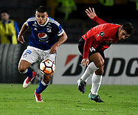 BOGOTA - COLOMBIA – 17 - 04 - 2018: Jhon Duque (Izq.) jugador de Millonarios (COL), disputan el balon con Carlos Sierra (Der.) jugador de Deportivo Lara (VEN), durante partido entre Millonarios (COL) y Deportivo Lara (VEN), de la fase de grupos, grupo G, fecha 3 de la Copa Conmebol Libertadores 2018, en el estadio Nemesio Camacho El Campin, de la ciudad de Bogota. / Jhon Duque (L) player of Millonarios (COL), fights for the ball with Carlos Sierra (R) player of Deportivo Lara (VEN), during a match between Millonarios (COL) and Deportivo Lara (VEN), of the group stage, group G, 3rd date for the Conmebol Copa Libertadores 2018 in the Nemesio Camacho El Campin stadium in Bogota city. VizzorImage / Luis Ramirez / Staff.