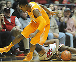 "Tennessee's Trae Golden (11)  hurdles Mississippi's Jarvis Summers (32) at the C.M. ""Tad"" Smith Coliseum on Thursday, January 24, 2013. Summers was called for walking on the play. Mississippi won 62-56 to improve to 5-0 in the SEC. (AP Photo/Oxford Eagle, Bruce Newman)"