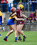 Alannah Ryan of Clare in action against Siobhan Mc Grath of Galway during their Minor A All-Ireland final at Nenagh.  Photograph by John Kelly.
