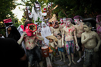 Salvadoran children, costumed, painted and wearing masks, perform indigenous mythology characters in the La Calabiuza parade at the Day of the Dead celebration in Tonacatepeque, El Salvador, 1 November 2016. The festival, known as La Calabiuza since the 90s of the last century, joins Salvador's pre-Hispanic heritage and the mythological figures (La Sihuanaba, El Cipitío, La Llorona etc.) collected from the whole Central American region, together with the catholic All Saints Day holiday and its tradition of honoring the dead relatives. Children and youths only, dressed up in scary costumes and carrying painted carts, march from the local cemetery to the downtown plaza where the party culminates with music, dance, drinking and eating pumpkin (Ayote) with honey.