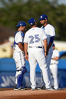 Dunedin Blue Jays pitching coach Vince Horsman (25) talks with catcher Jorge Saez (12) and pitcher Jairo Labourt (47) during a game against the Bradenton Marauders on April 14, 2015 at Florida Auto Exchange Stadium in Dunedin, Florida.  Bradenton defeated Dunedin 7-1.  (Mike Janes/Four Seam Images)