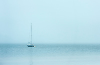 Boat in Pleasant Bay on overcast morning, North Chatham, Cape Cod, Massachusetts, USA.